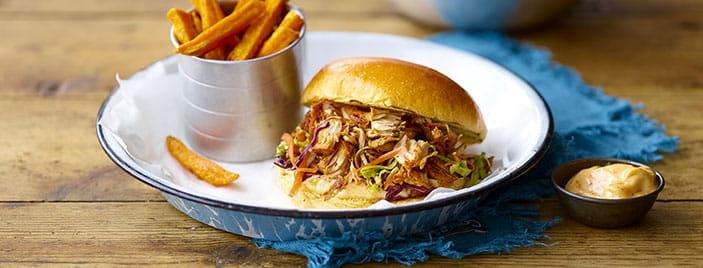 BBQ pulled jackfruit burger with slaw and sweet potatoes in a bowl