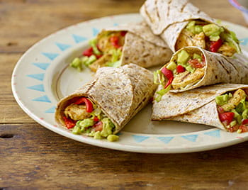 5 Mexican chicken wrap with guacamole on a white plate