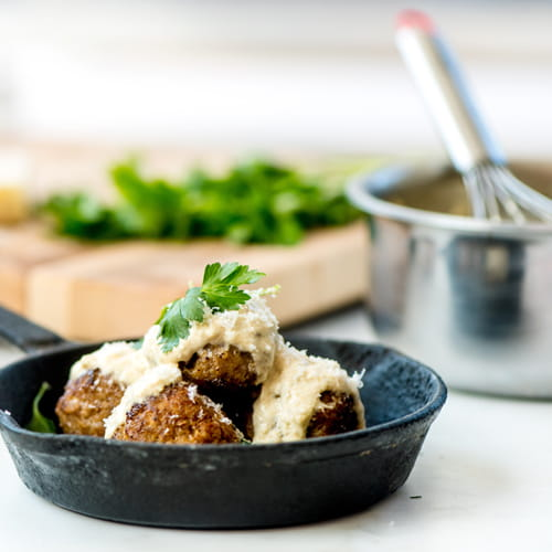 Zesty Pork Meatballs with Cumin and Garlic Cream