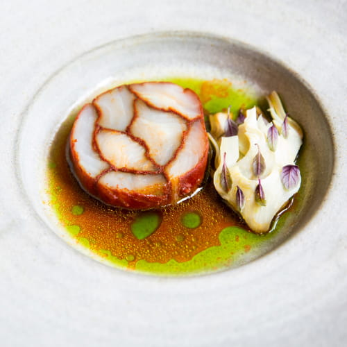Paprika Marbled Halibut with Artichokes, Eggplant, Black Garlic & Tomato Broth with Samphire Oil