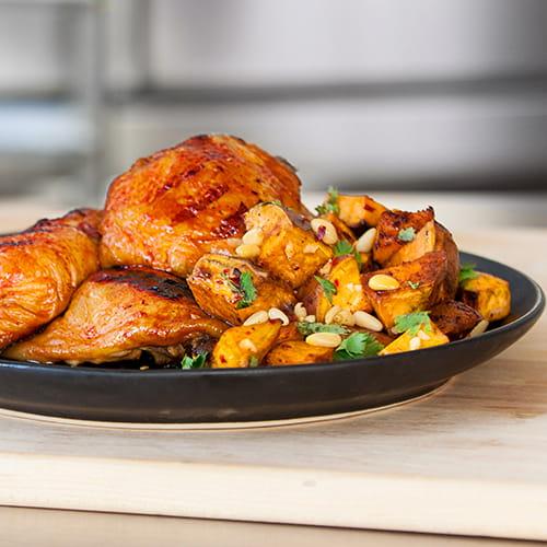 Cuisses de poulet fumé et salade chaude de patates douces