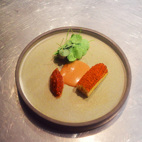 Crayfish with Coconut Bisque, Grilled Corn with Fiery Habanero and Garlic, Crayfish Butter, Burnt Tomato Puree, Nasturtium