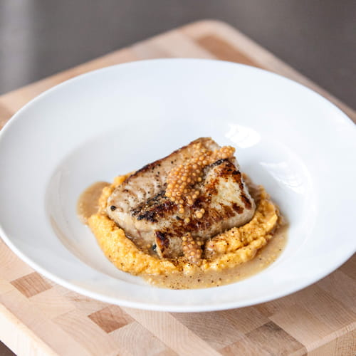 Eel A La Plancha with Brown Sugar Bourbon Romesco and Sherry Mustard Seed Vinaigrette