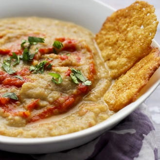Roasted Eggplant Harissa Bisque with Parmesan Tuiles