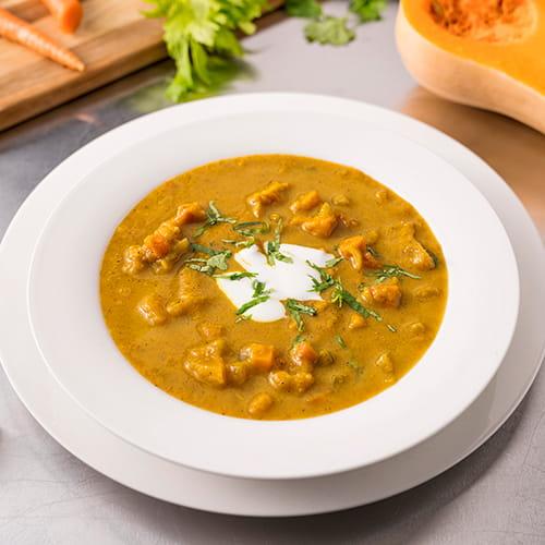Soupe au garam masala, aux carottes et à la courge musquée grillés