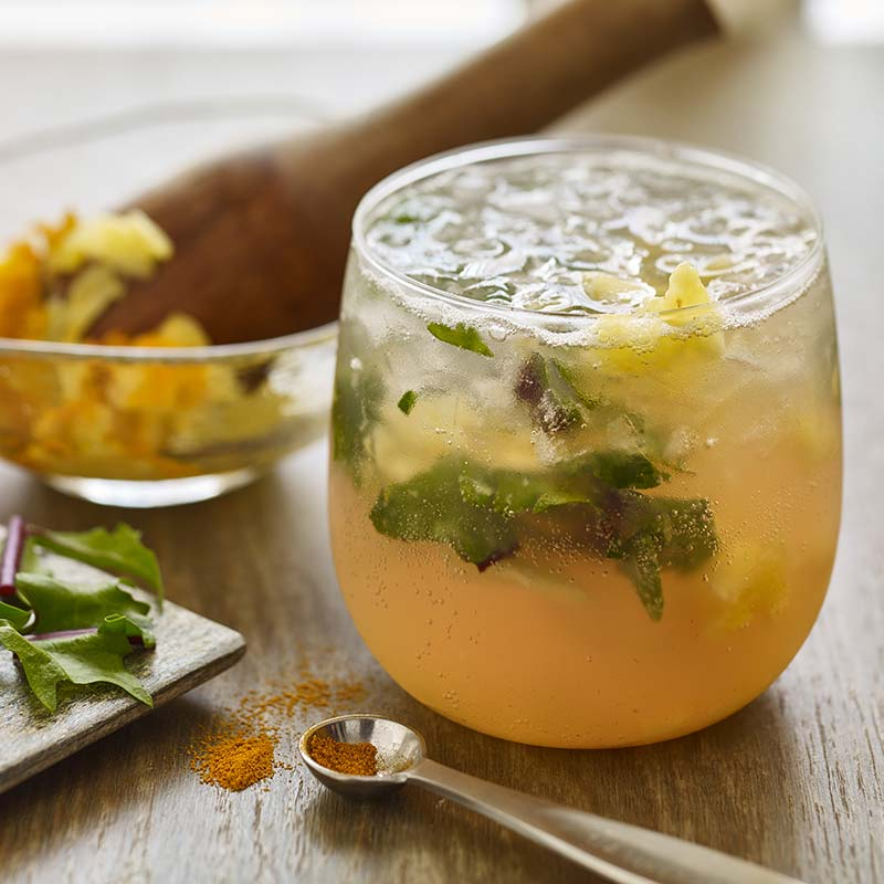 Pineapple Turmeric Mocktail with Muddled Dandelion Greens