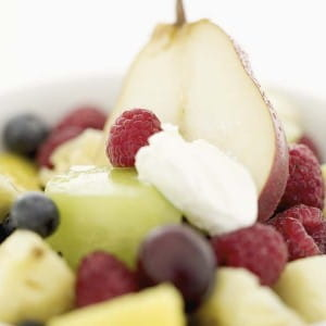 Fruit salad can make a great side dish for a Mexican huevos motulenos