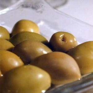 Top off a sandwich with an olive
