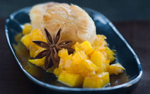 Seared scallops with reduction of star anise and peppered pineapple