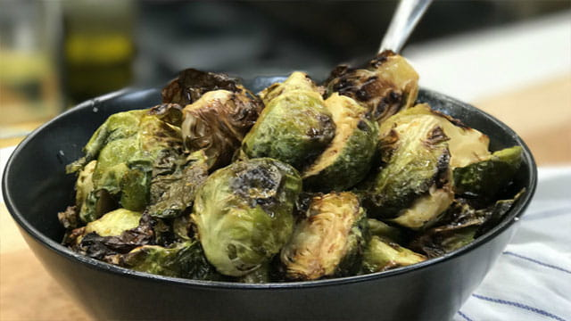 ROASTED BRUSSELS SPROUTS WITH HONEY SRIRACHA GLAZE