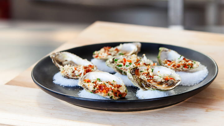 Local Oysters Oreganato and Sriracha Vinaigrette