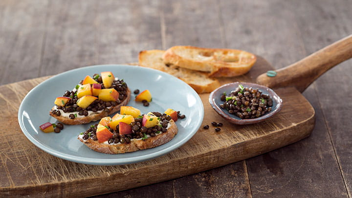 Pickled Peach and Black Beluga Lentil Toasts