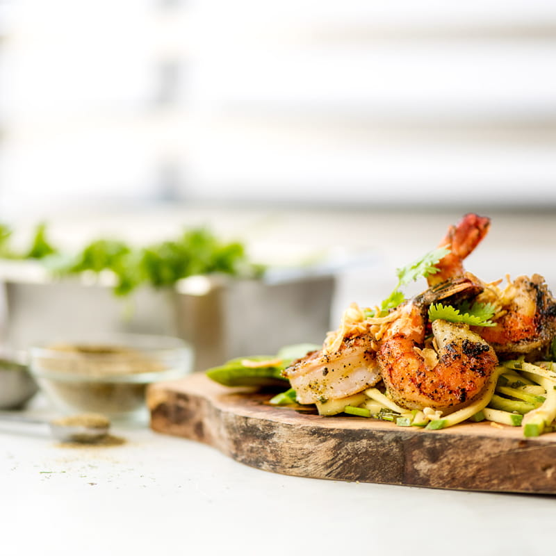 Grilled Black Pepper Shrimp with Green Mango and Avocado Slaw