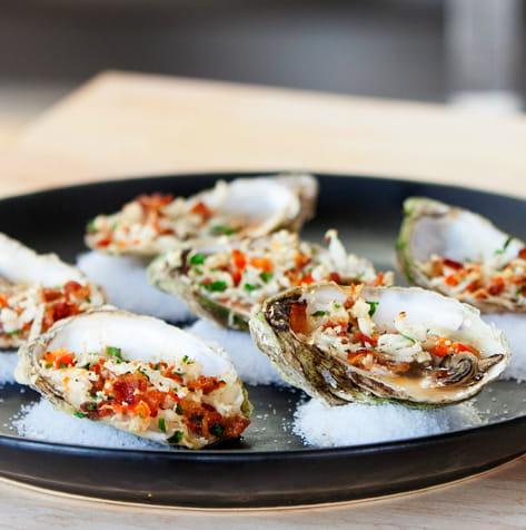 Local Oysters Oreganato and Sriracha Vinaigrette