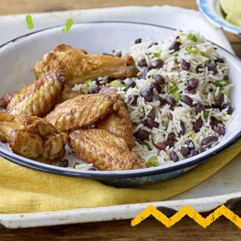 Caribbean Jerk kipvleugels met rijst en erwten